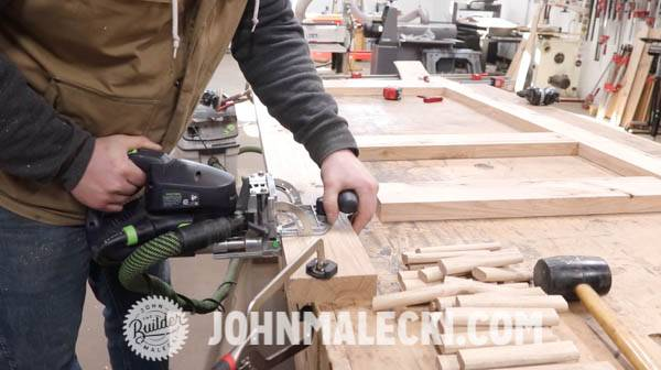 John malecki cuts domino joinery on his DIY door panels