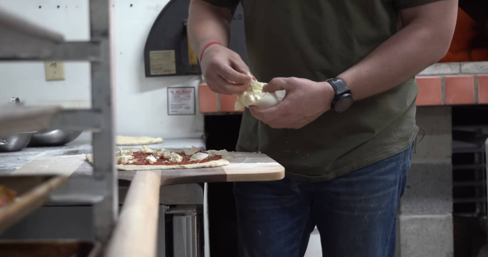 John Malecki makes pizza on a DIY pizza peel
