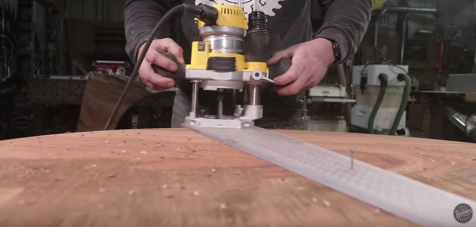 john malecki routes the edge of a wood slab coffee table
