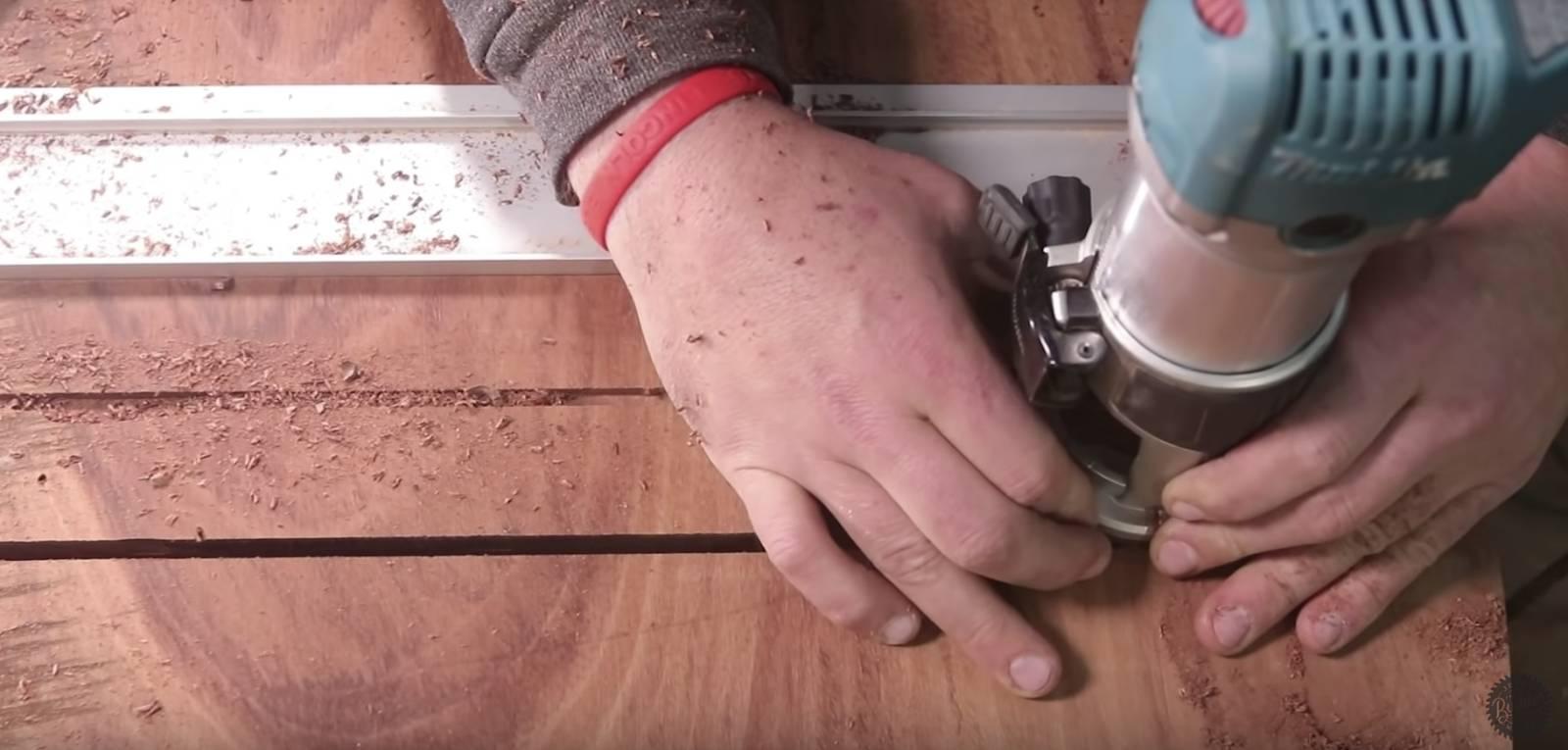john malecki lays c-channel of a wood slab coffee table