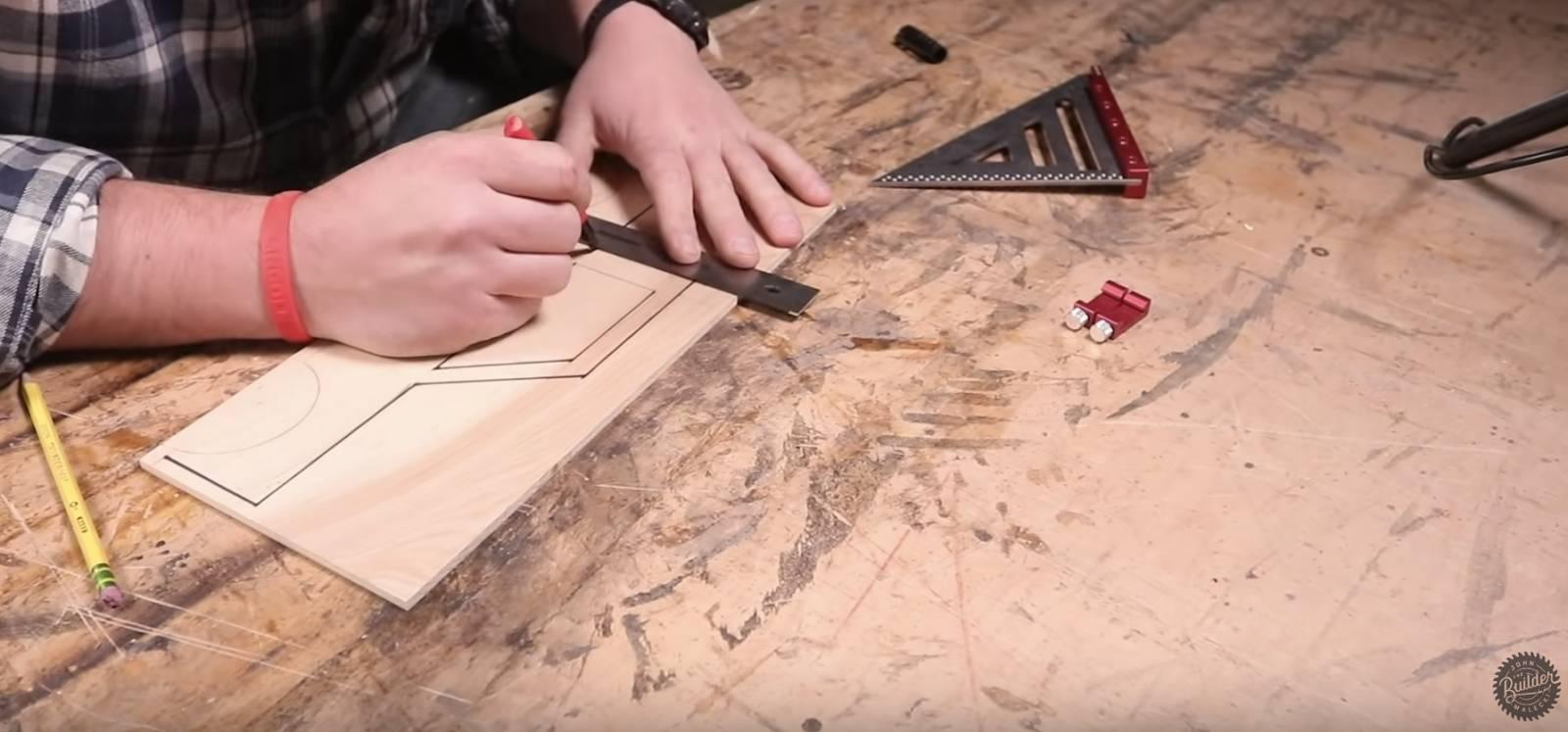 John malecki makes the template for wooden toy trucks