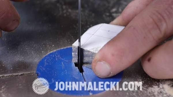 John Malecki cuts drawer pulls out of soft brass