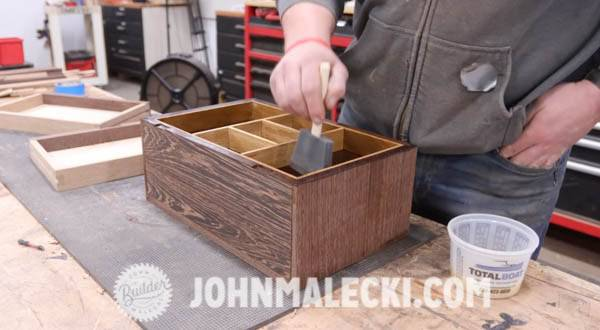 John Malecki sands and shellacs the jewelry box