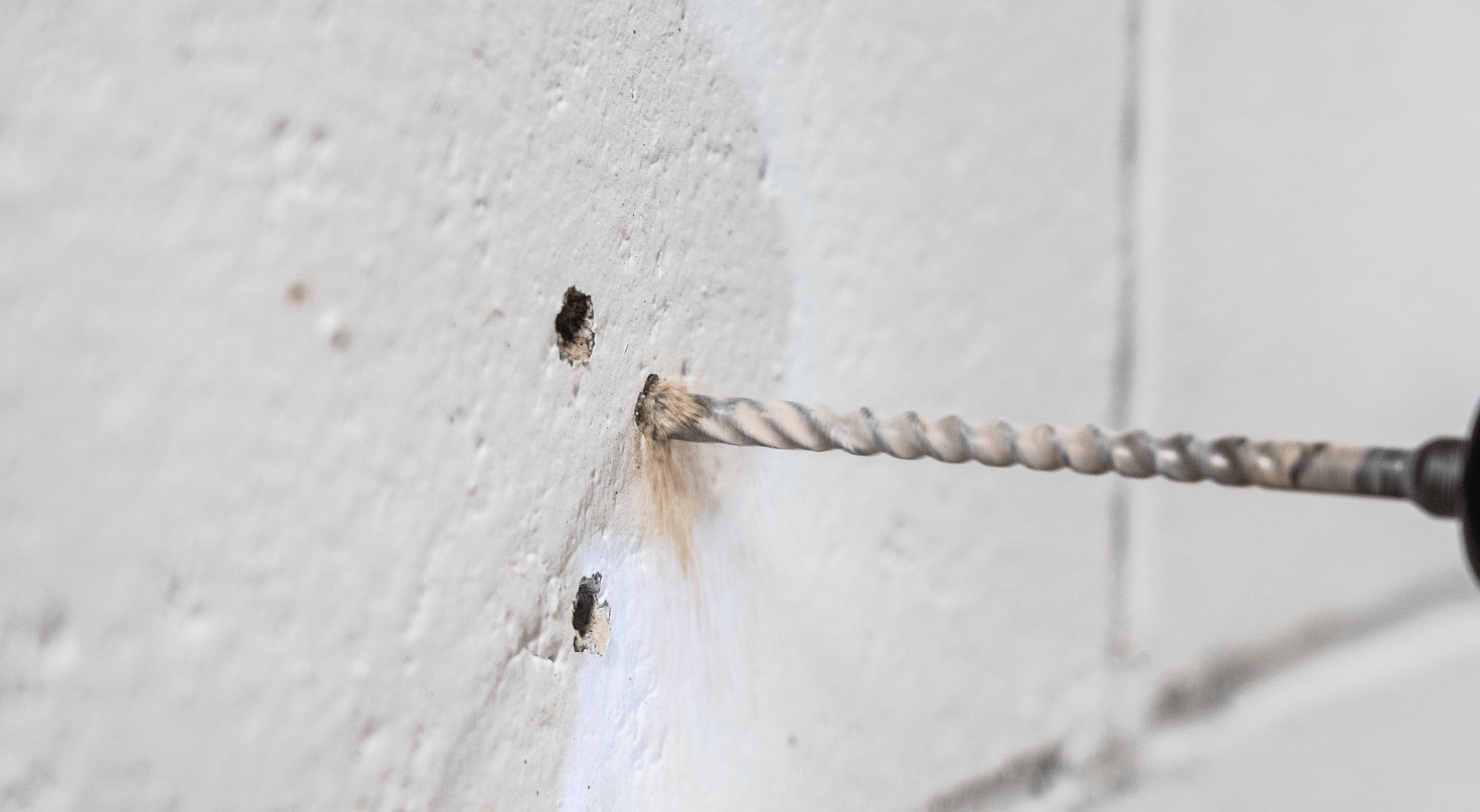 drill bit in cement wall