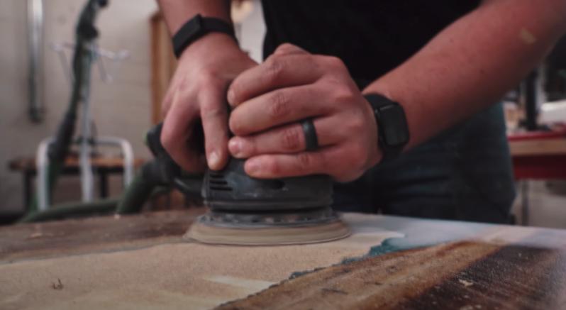a men is cutting wood