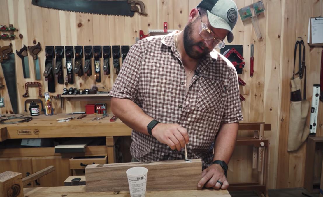 john malecki placing glue on wood