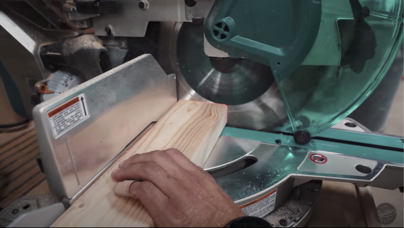 person sawing through wood