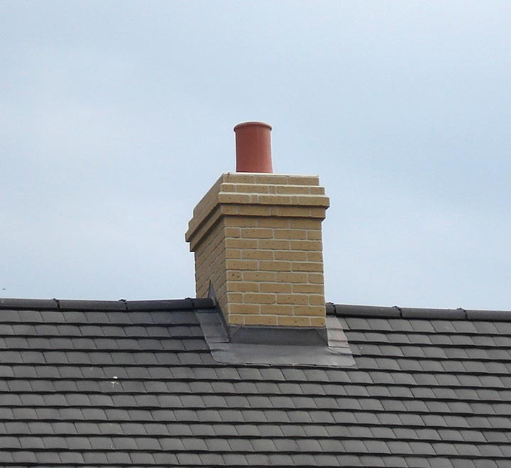 Brick slip chimney attached to roof