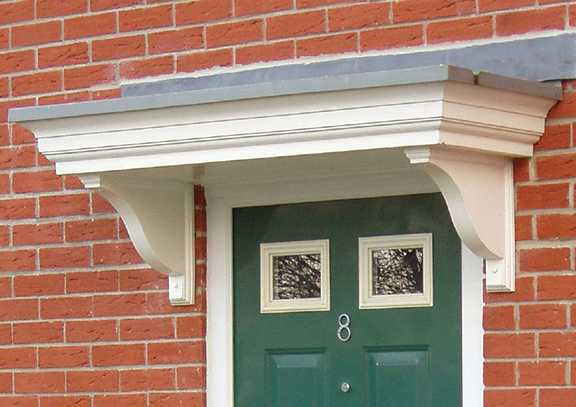 Glass reinforced canope above door with brick wall behind