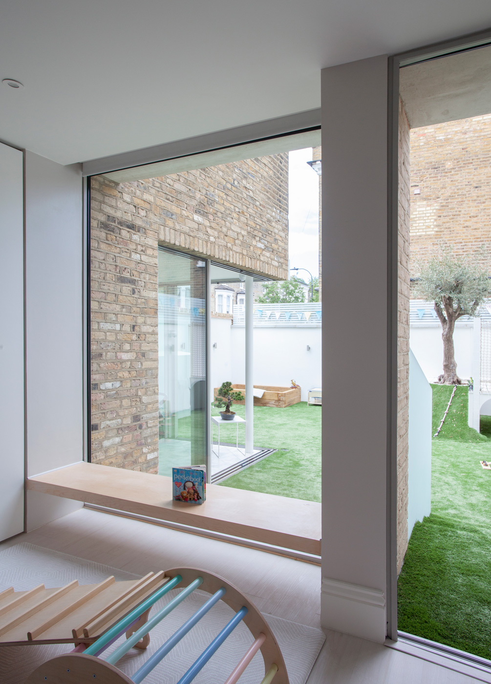 Refurbishment and extension of a 1930's house in South London, to convert an existing side garage to create a new open plan kitchen, dining and living space.