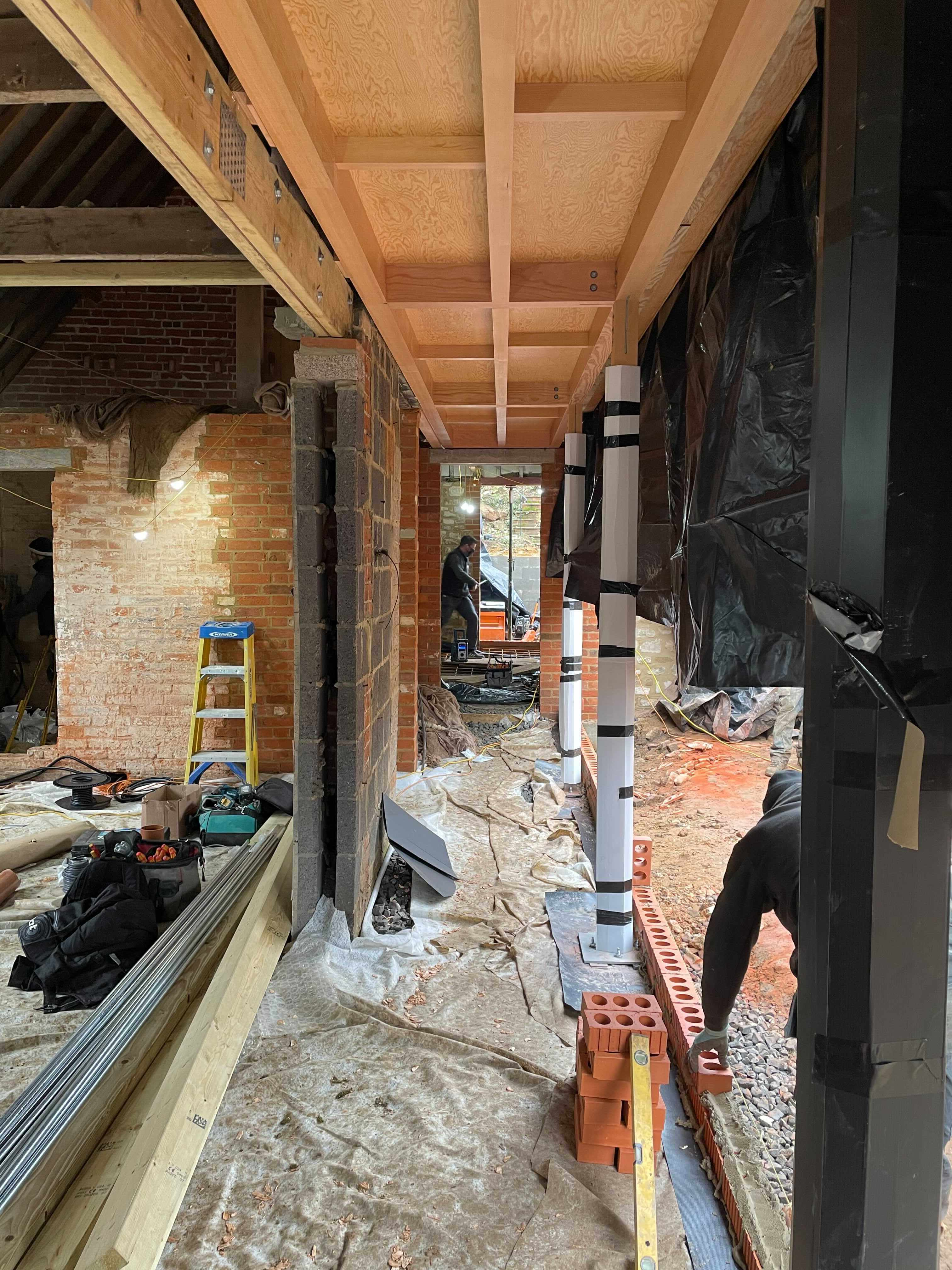 A series of lightweight timber framed extensions to retrofit an existing stone haybarn in Godalming, Surrey to create a new family home.