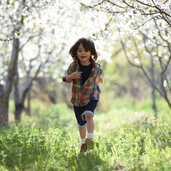 a boy running through a field