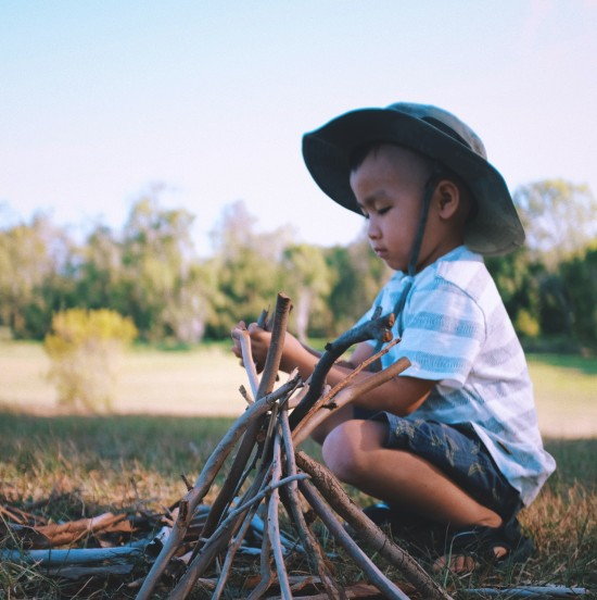 a boy playing with sticks