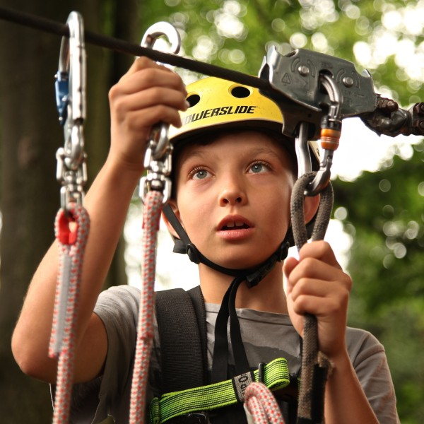 a boy on a rope course