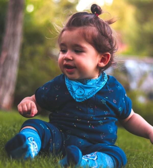a little girl smiling in a field