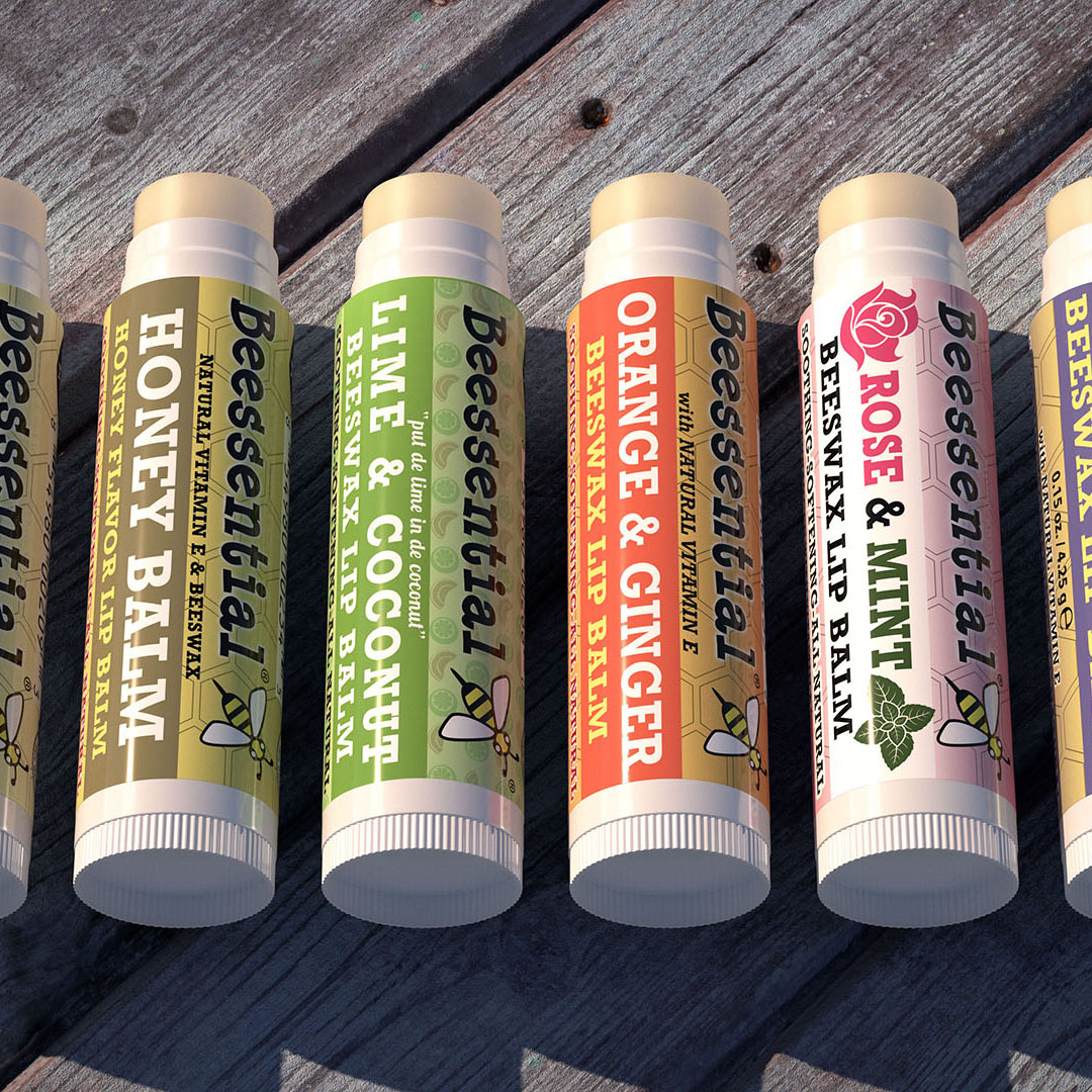 Beetanical's lip balm products on a wooden table top