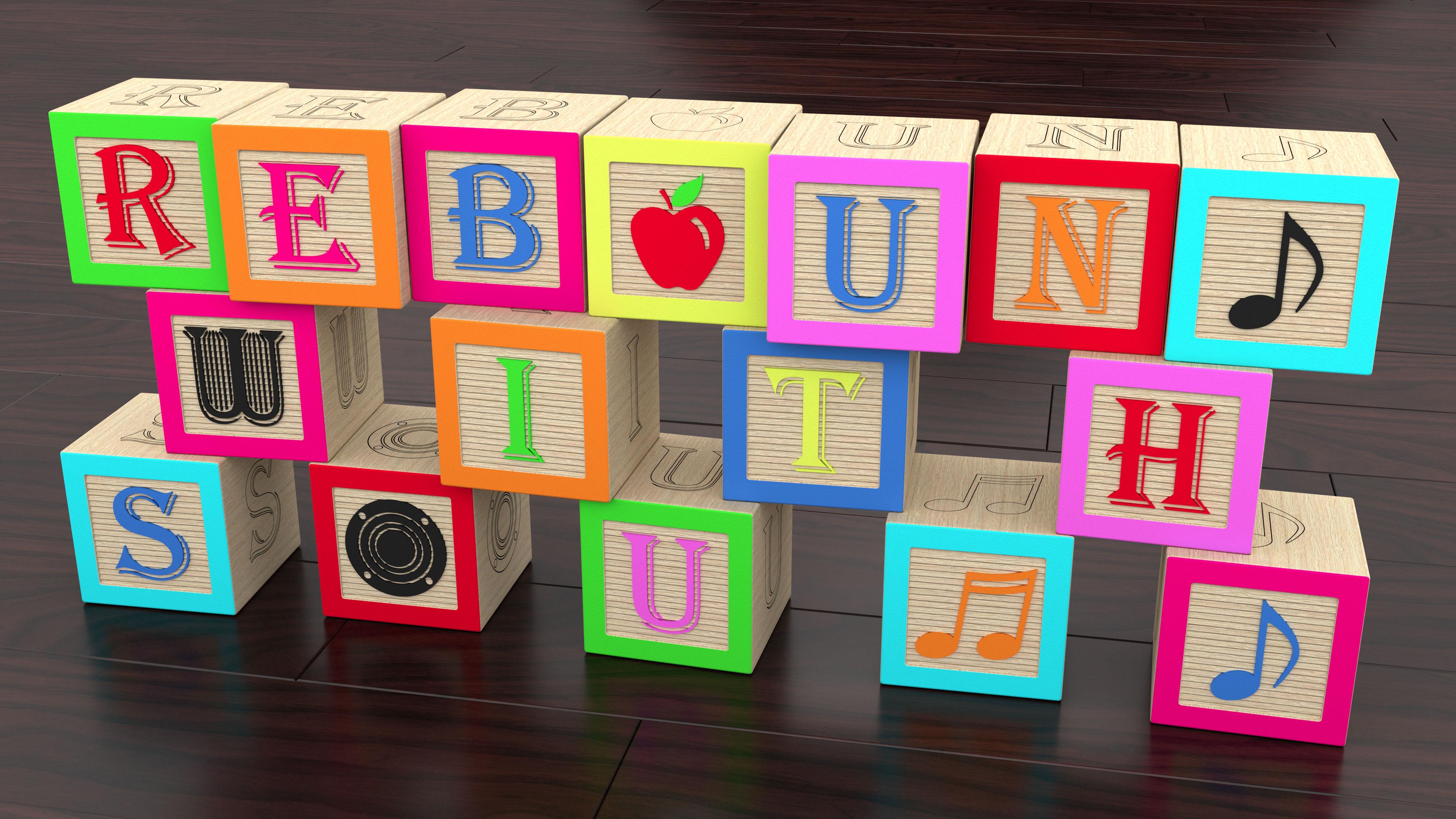 Rebound with Sound logo spelled with kids building toy blocks