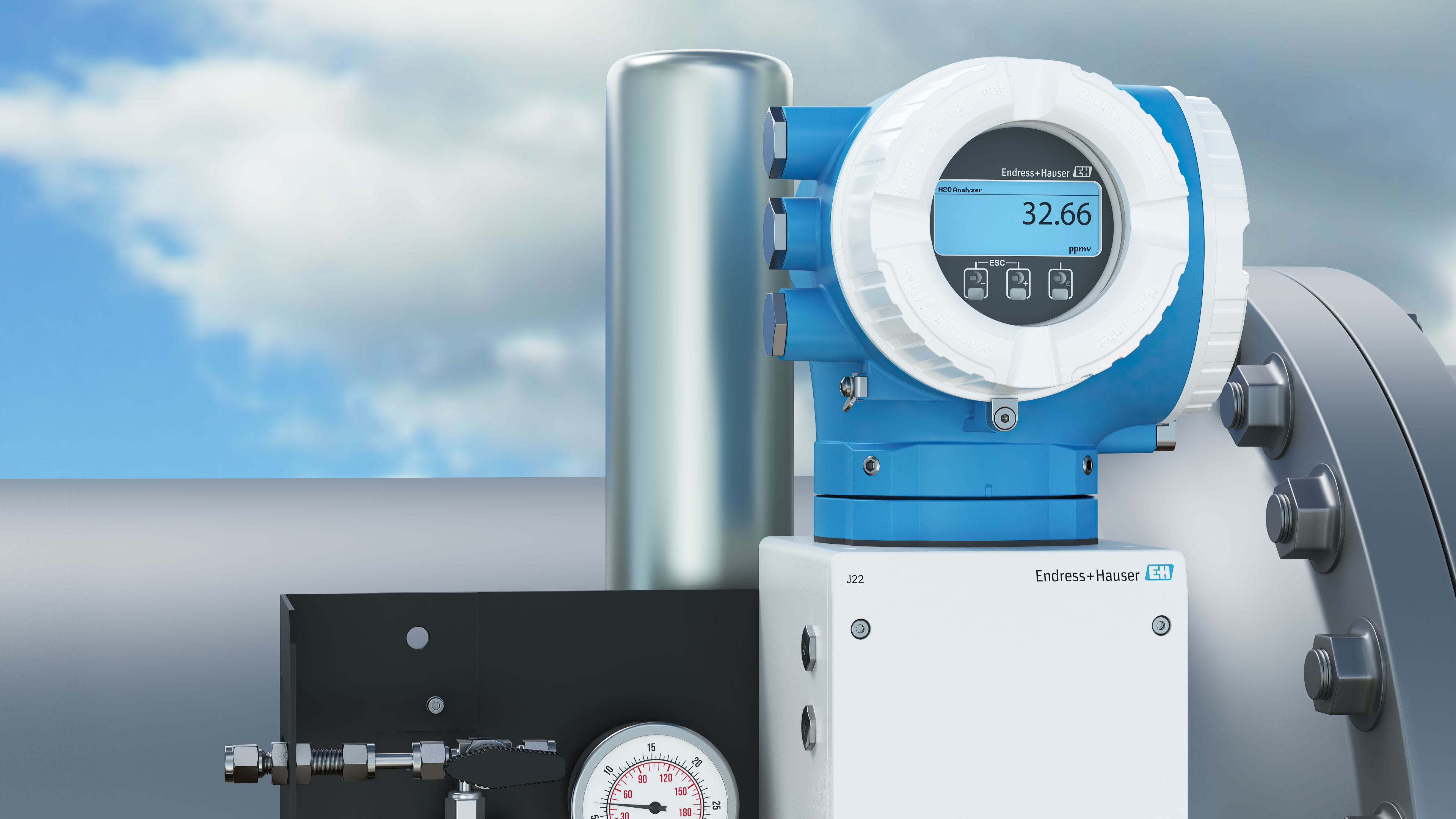 SpectraSensor J22 Gas Analyzer with pipeline and clouds in the background