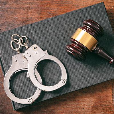 Criminal defense lawyer handcuffs.
