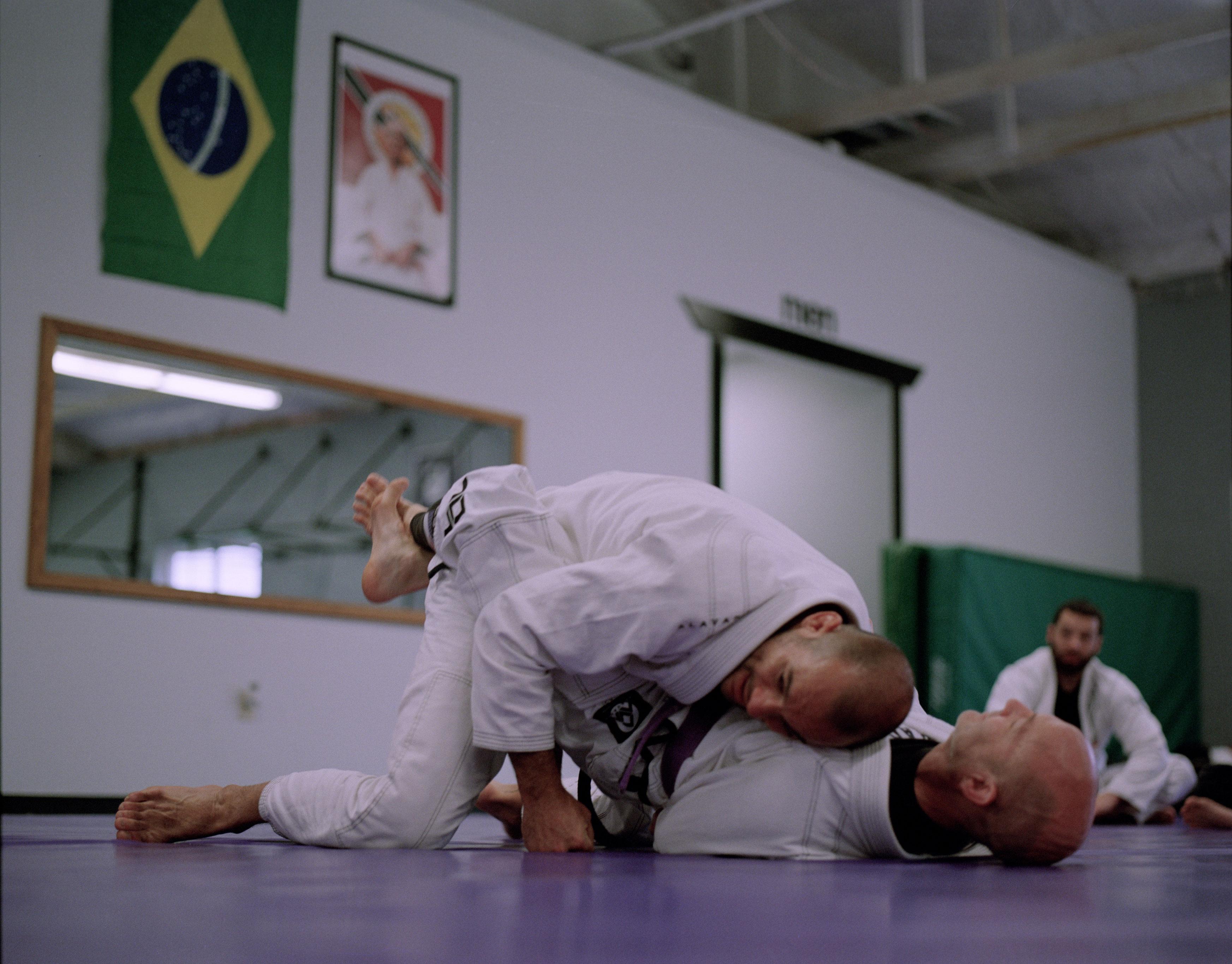 Ryron Gracie rolling with juijitsu instructor, John Ingallina
