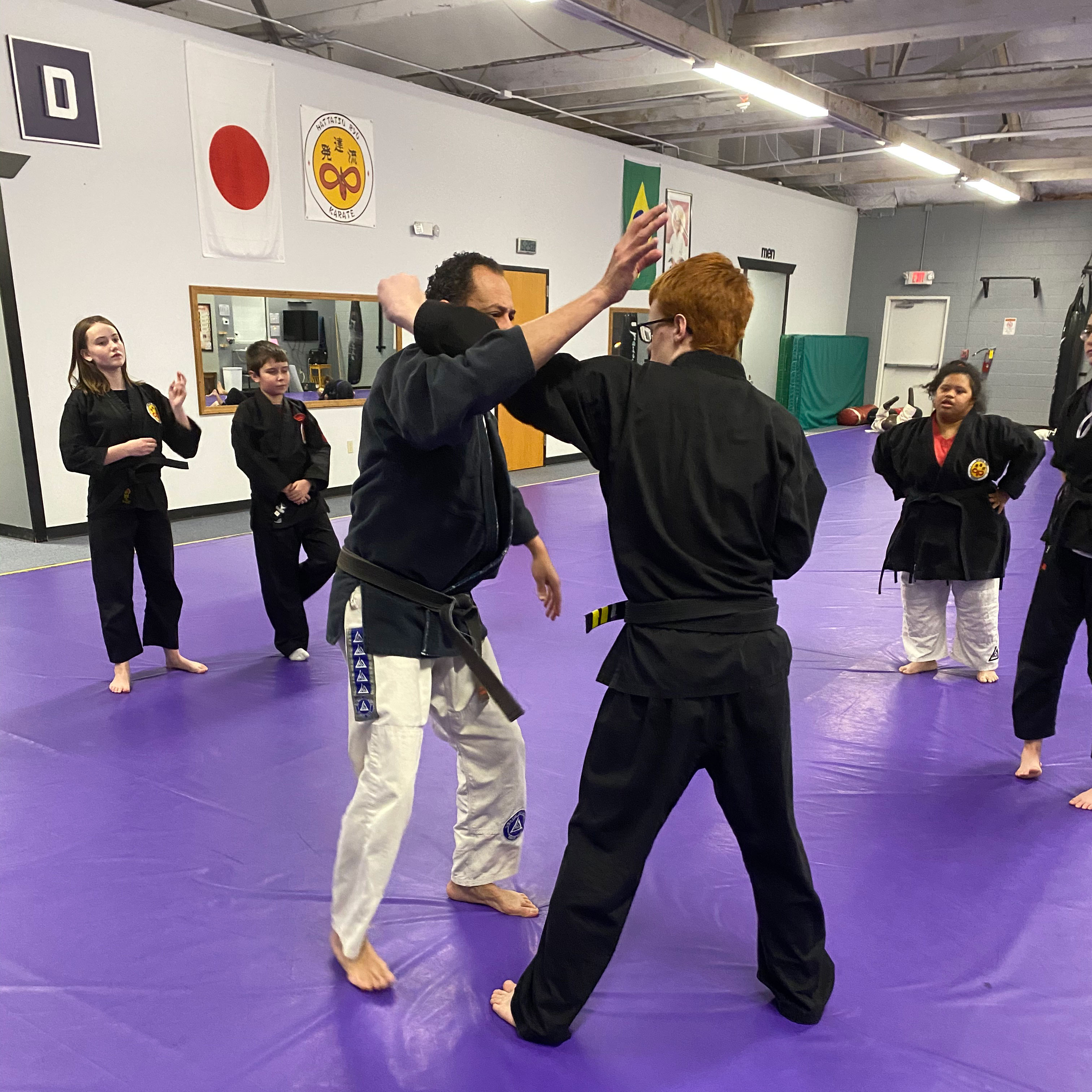 Kids blocking instructor's punch in kids martial arts class