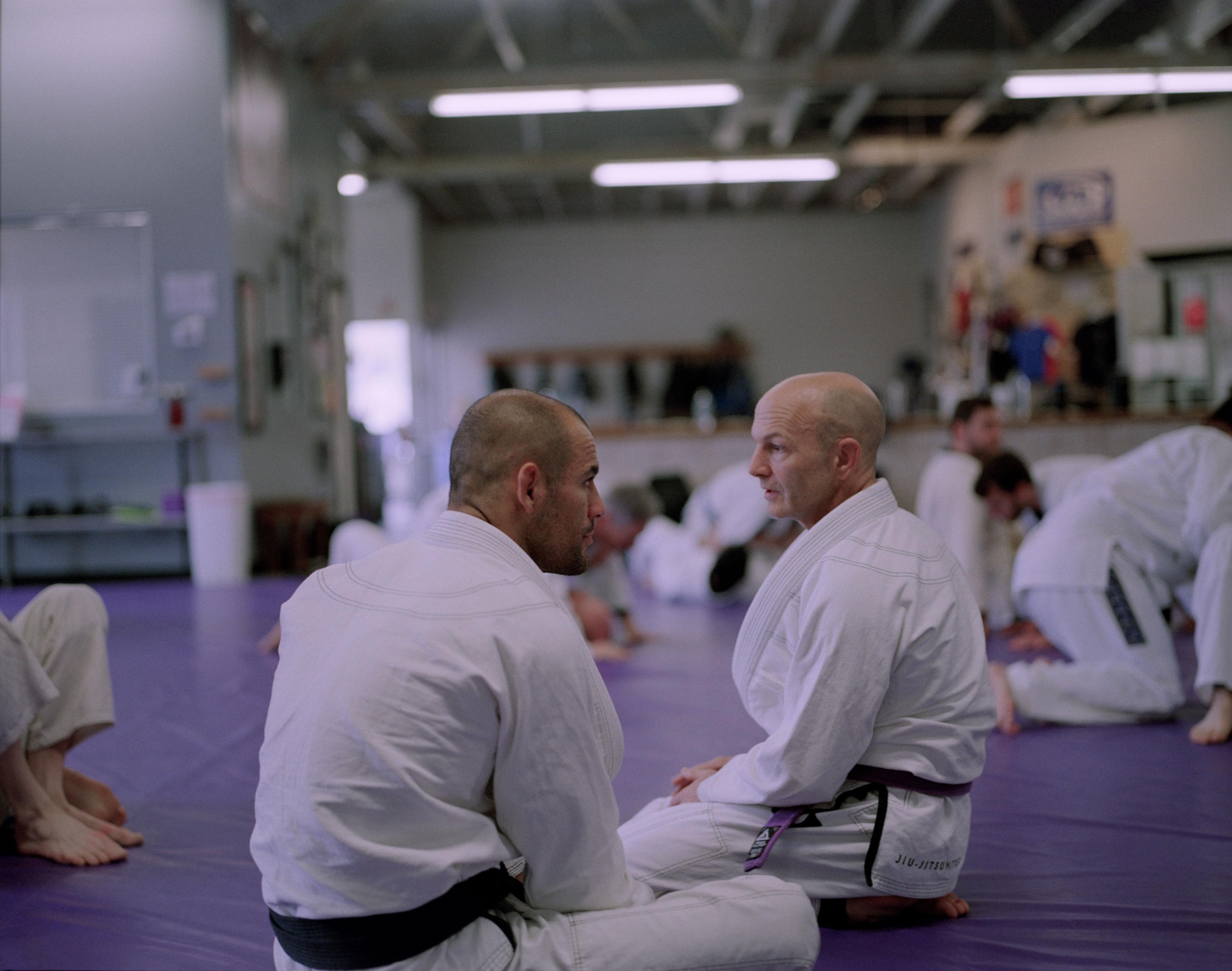 Gracie juijitsu instructor, John Ingallina, talking with Ryron Gracie