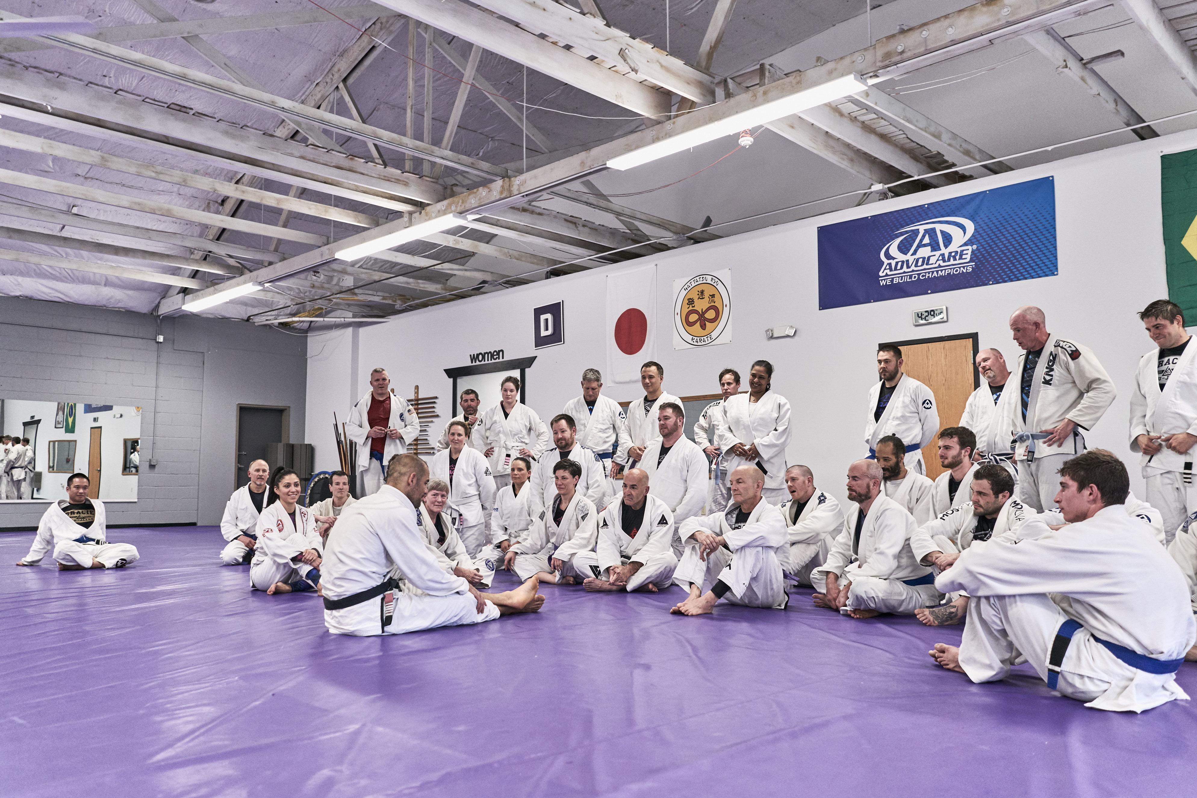 Gracie jui-jitsu students listening to Ryron Gracie during seminar