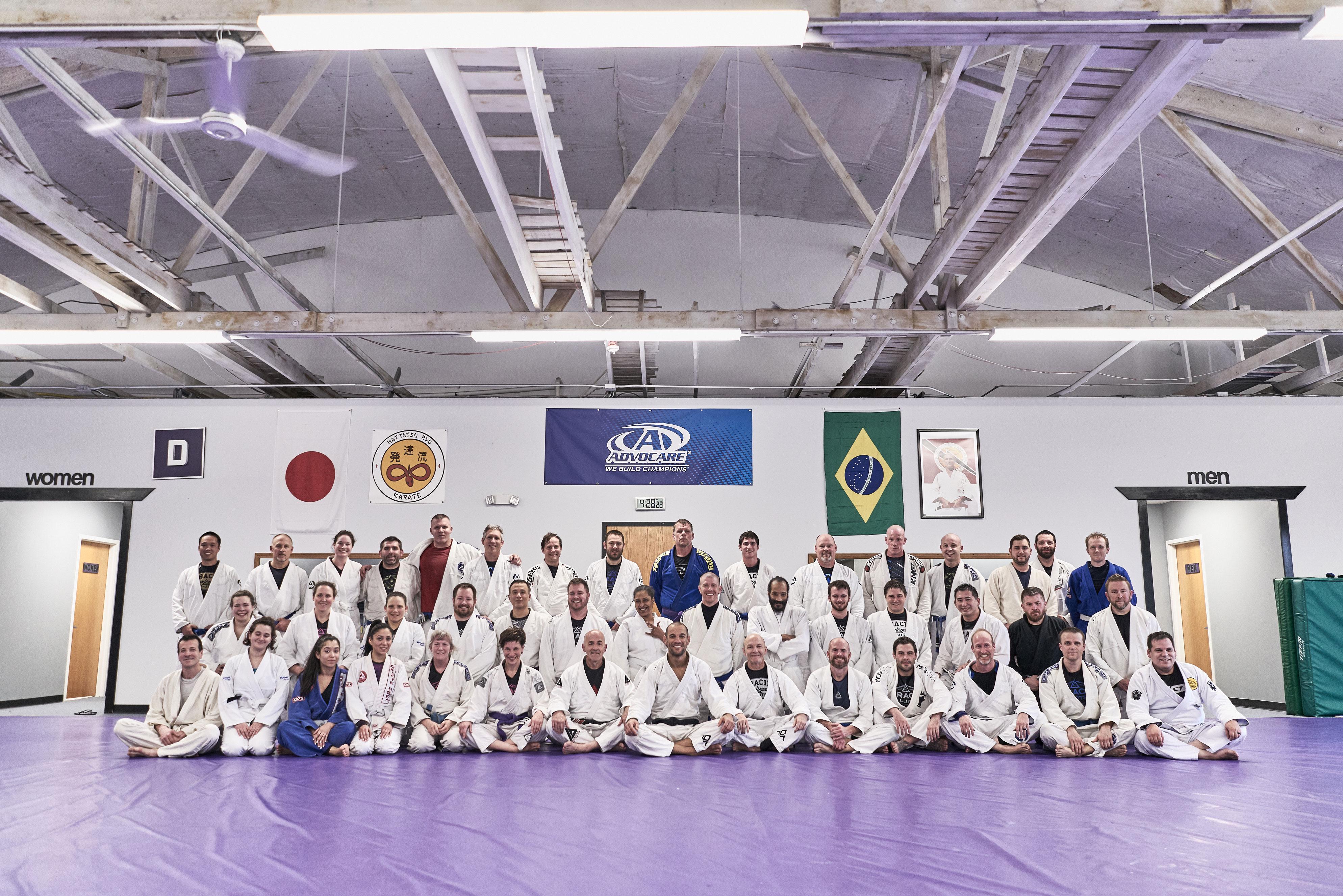 Large group of Gracie jui-jitsu students smiling at camera