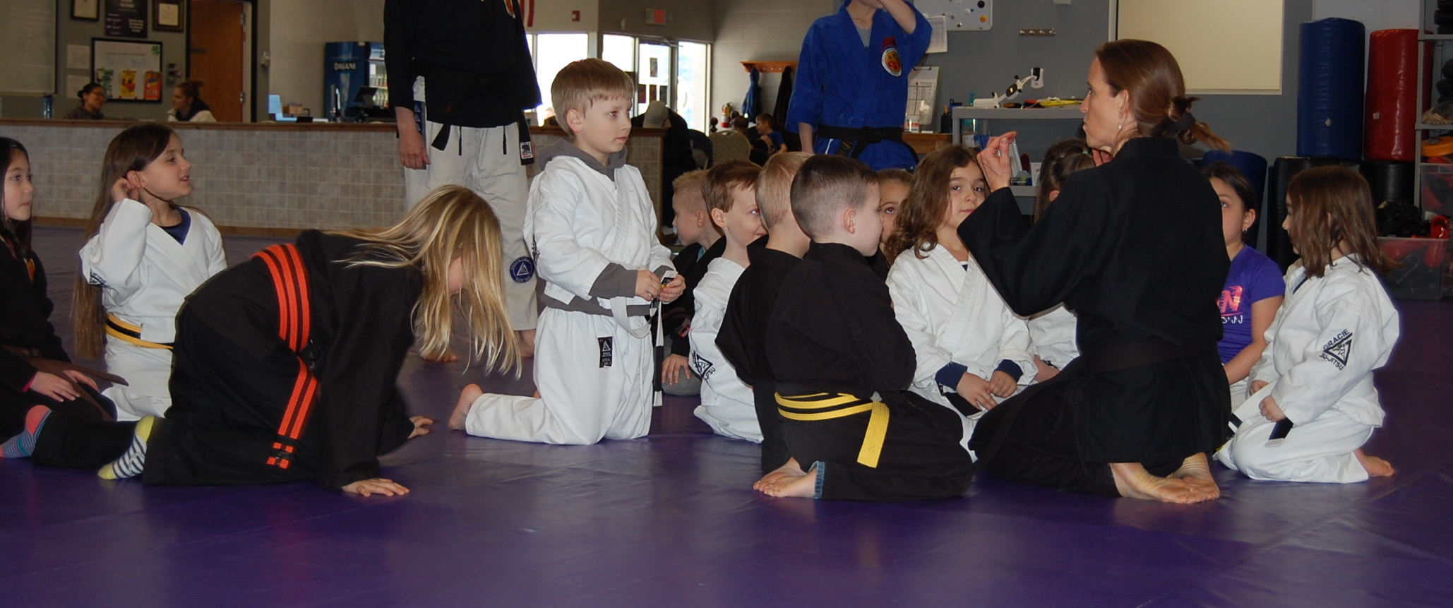 Kids learning self-defense by practicing juijitsu techniques