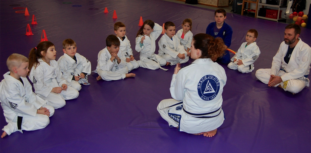 Karate instructor teaching kids martial arts class