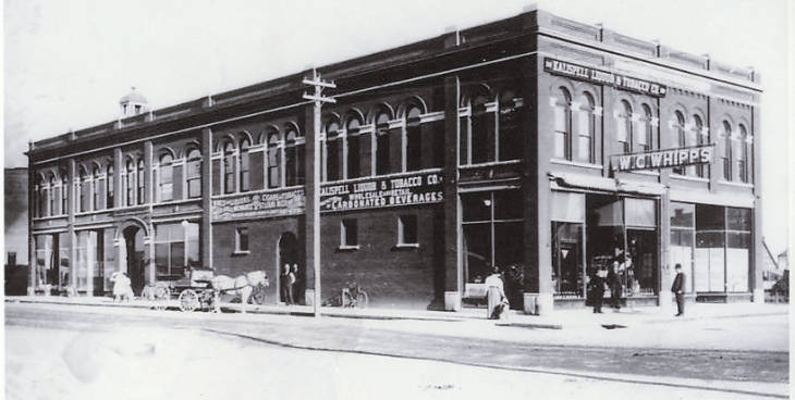The Whipps block, 3rd  and  Main Streets in Kalispell, soon after construction in 1904. William C. Whipps, four term Mayor of Kalispell and owner of Kalsipell Liquor  and  Tobacco Company, had this building constructed the same year the Great Northern Railway moved its division point from Kalispell to Whitefish. In 1909, Whipps built a matching addition on the south. b and w photo.