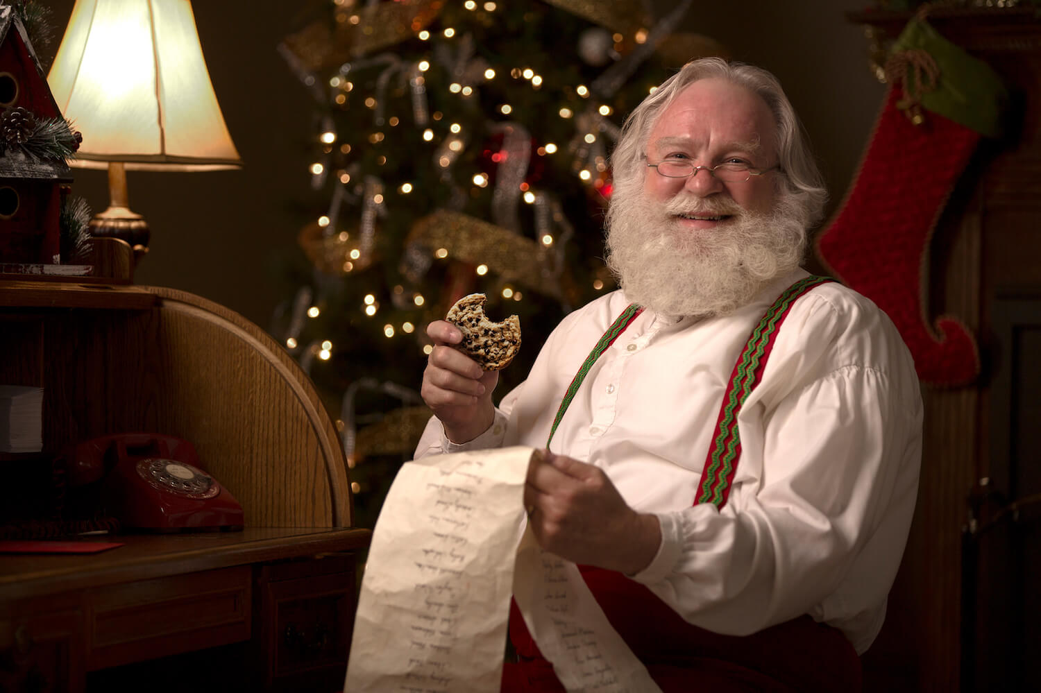 Photo of Santa holding a long paper list
