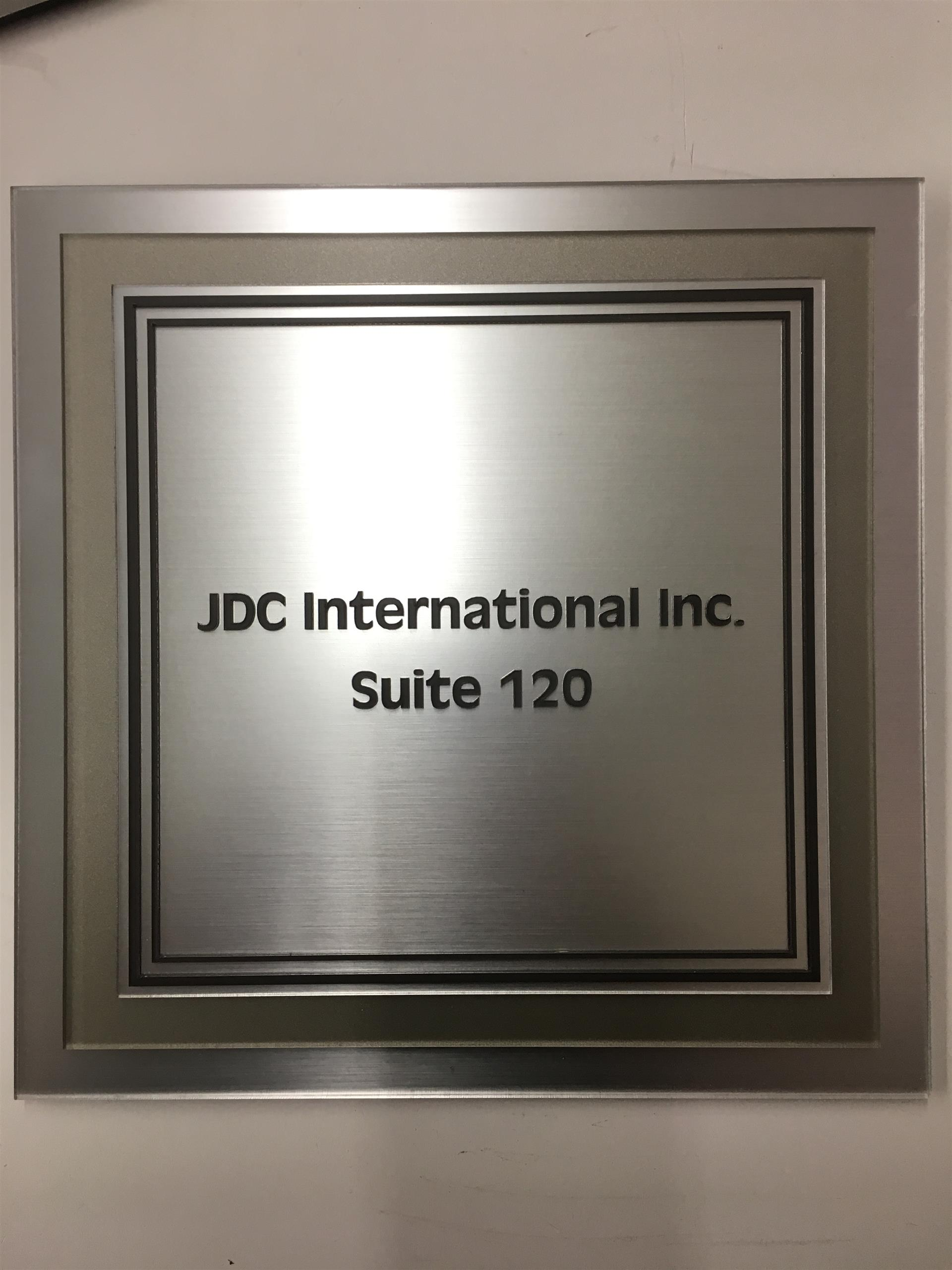 JDC International Inc. ADA Sign