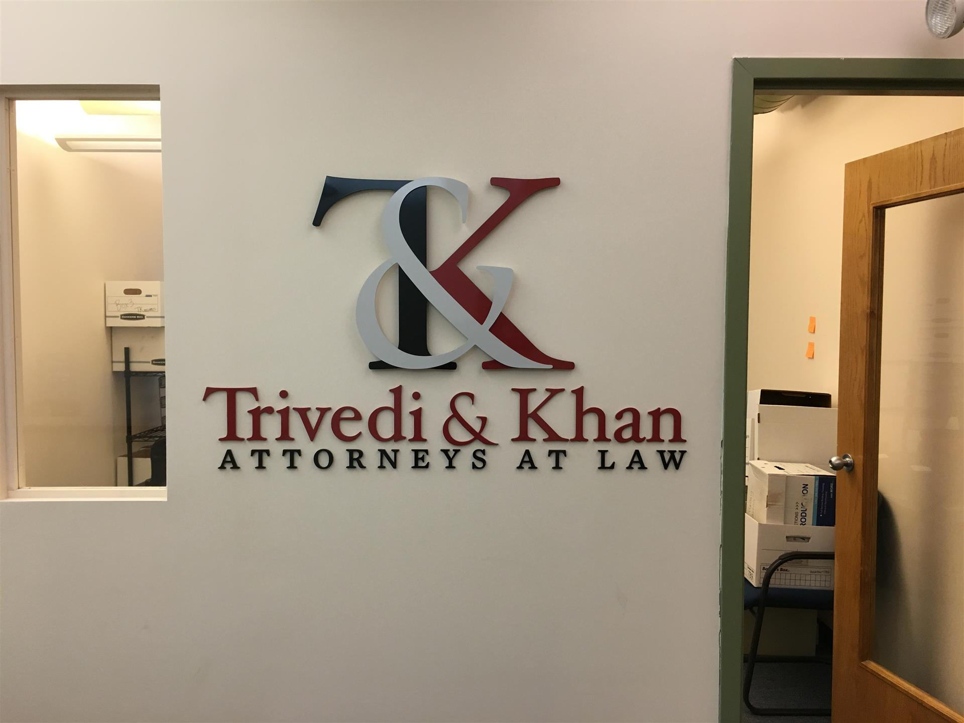 Trivedi & Khan Attorney at Law Lobby Sign