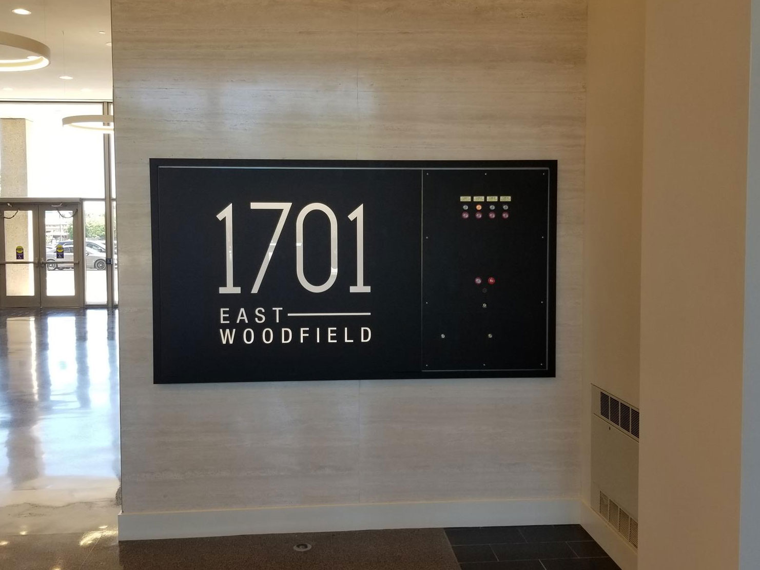 1701 East Woodfield Lobby Sign