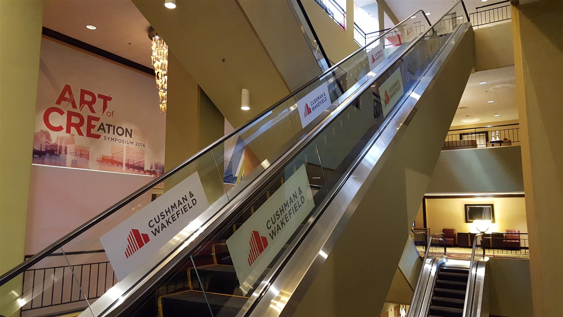 Cushman & Wakefield Escalator Signs