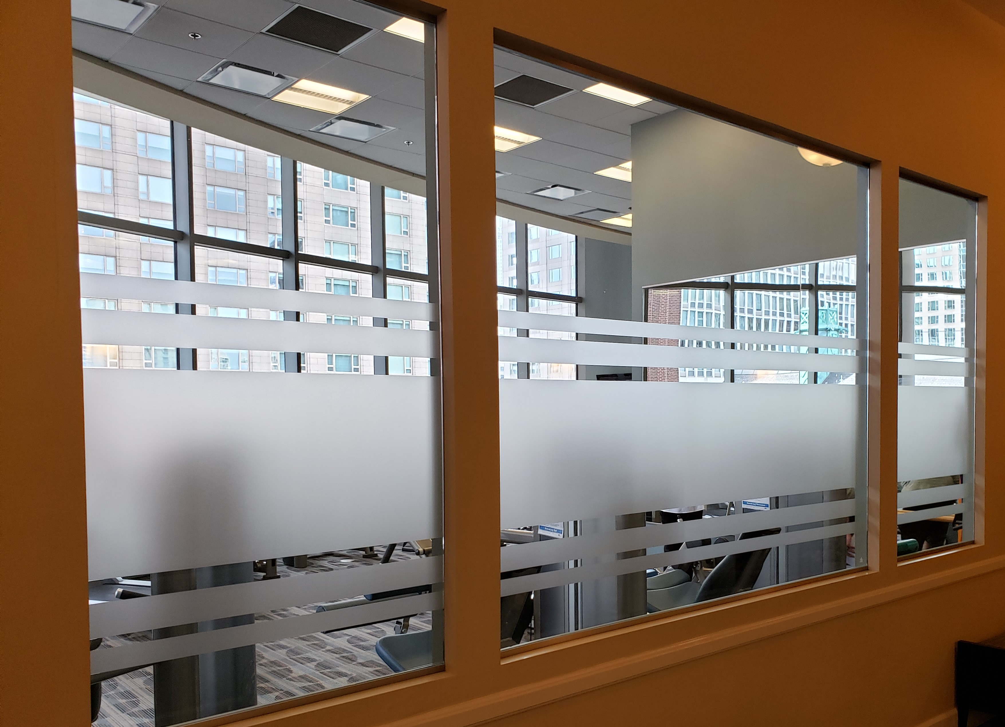 Frosted window graphics on conference room window