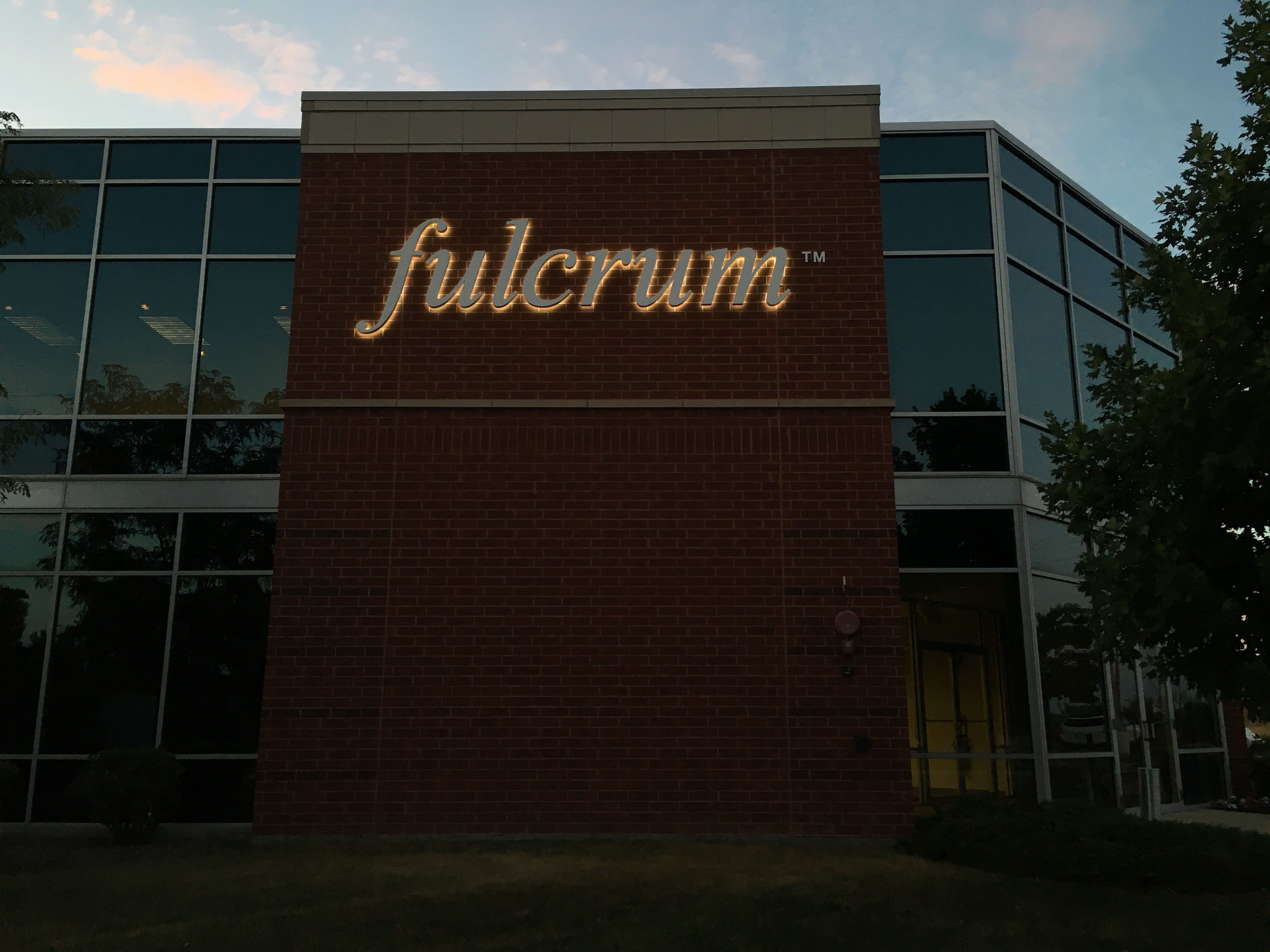 Fullcrum illuminated sign