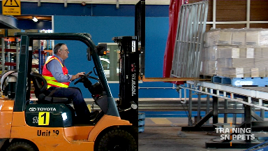 Forklift: Picking A Pallet From A Truck Tray