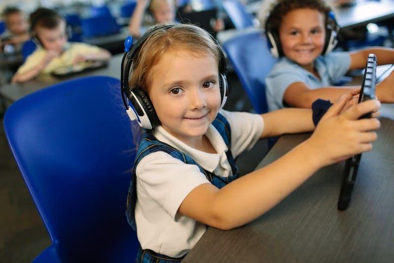 Happy Children with Tablet Christian School in Orange, CA