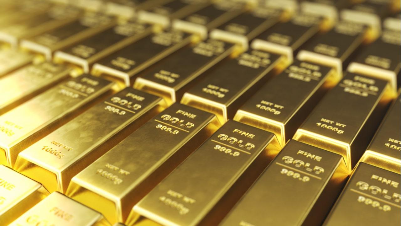 Diversas barras de ouro alinhadas, com os dizeres Fine Gold 999.9