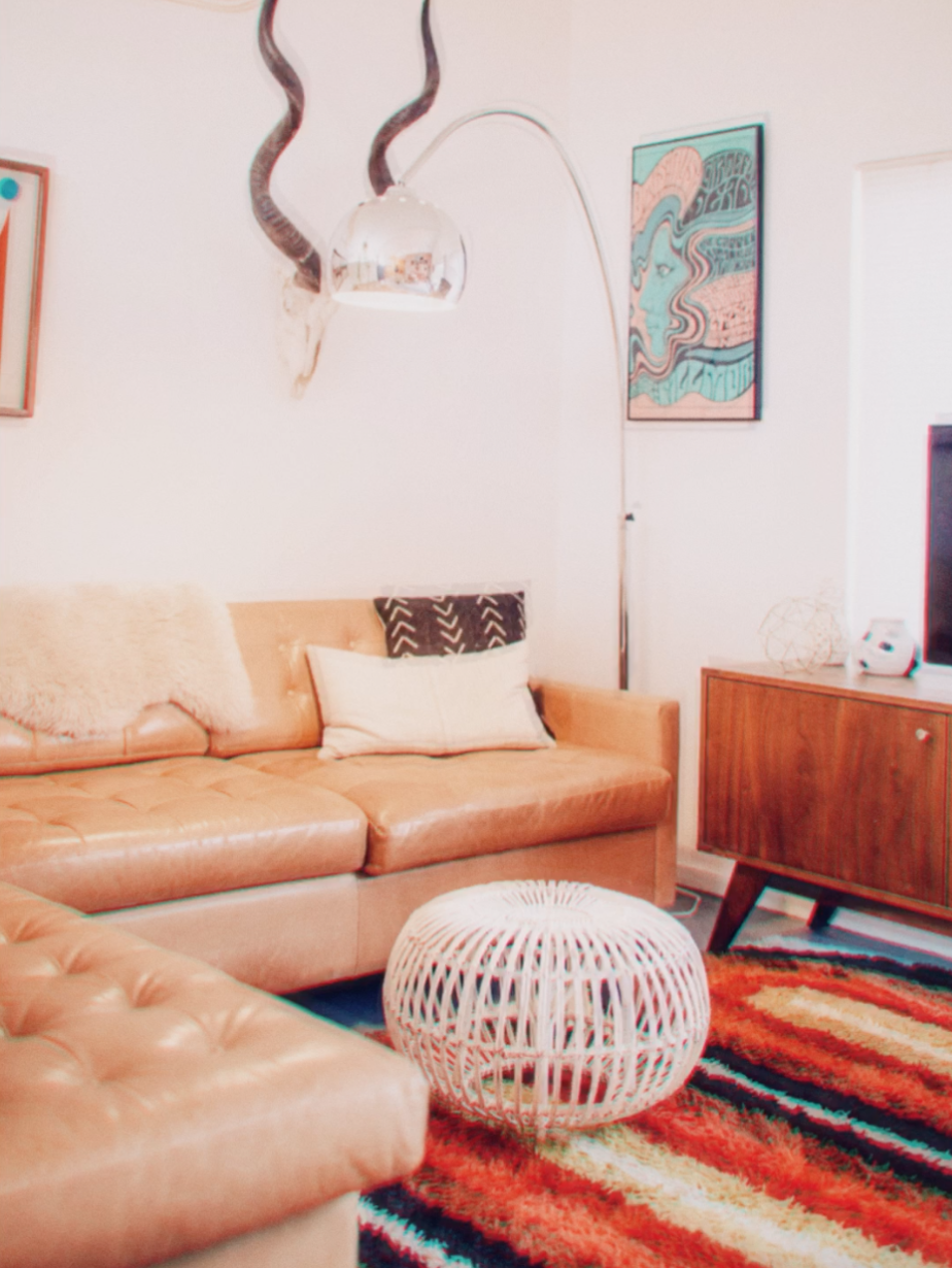 A retro living room with orange and red tones, filtered with Adam's Wingman look