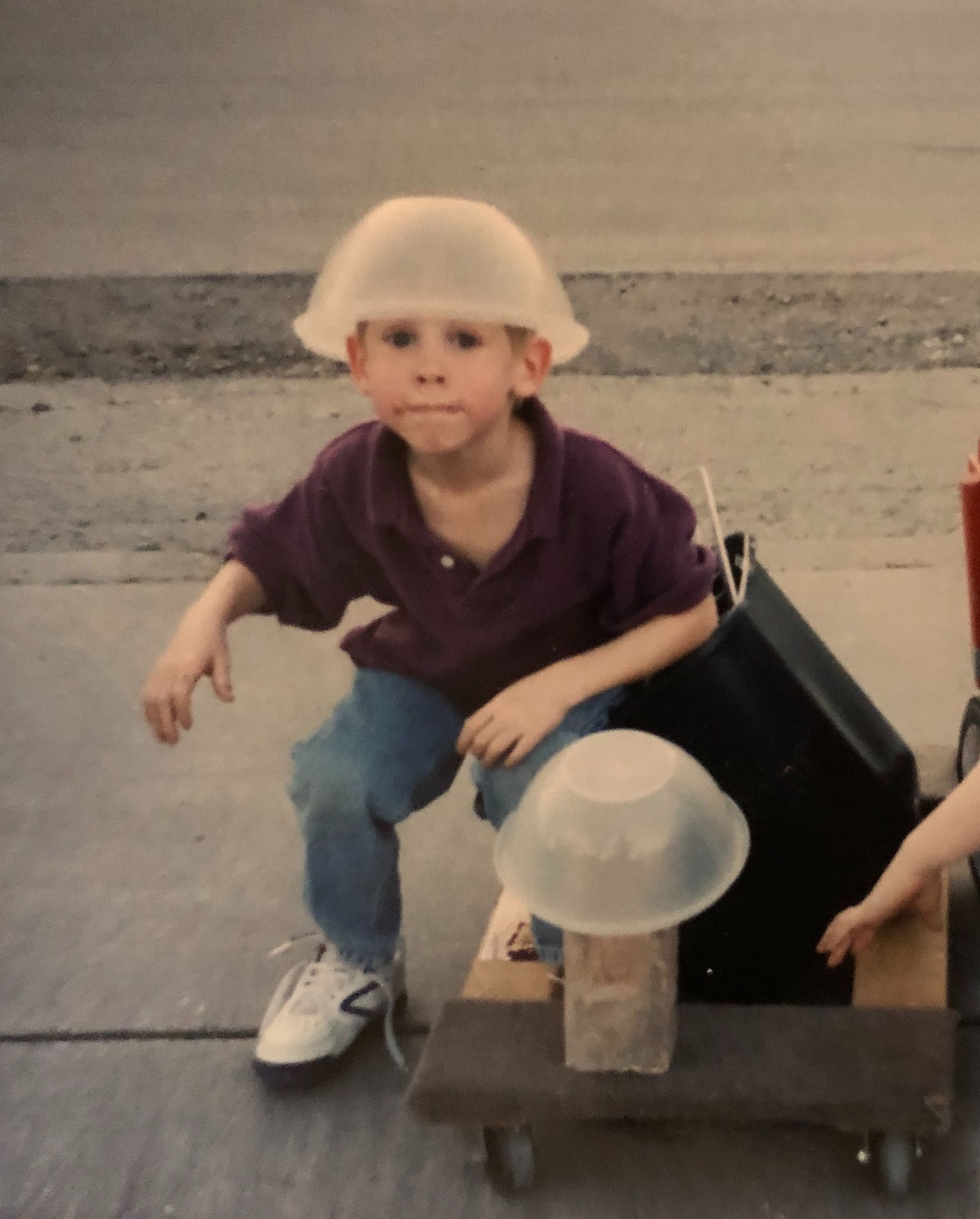 Phill Pasqual as a kid, posing with a bucket on his head
