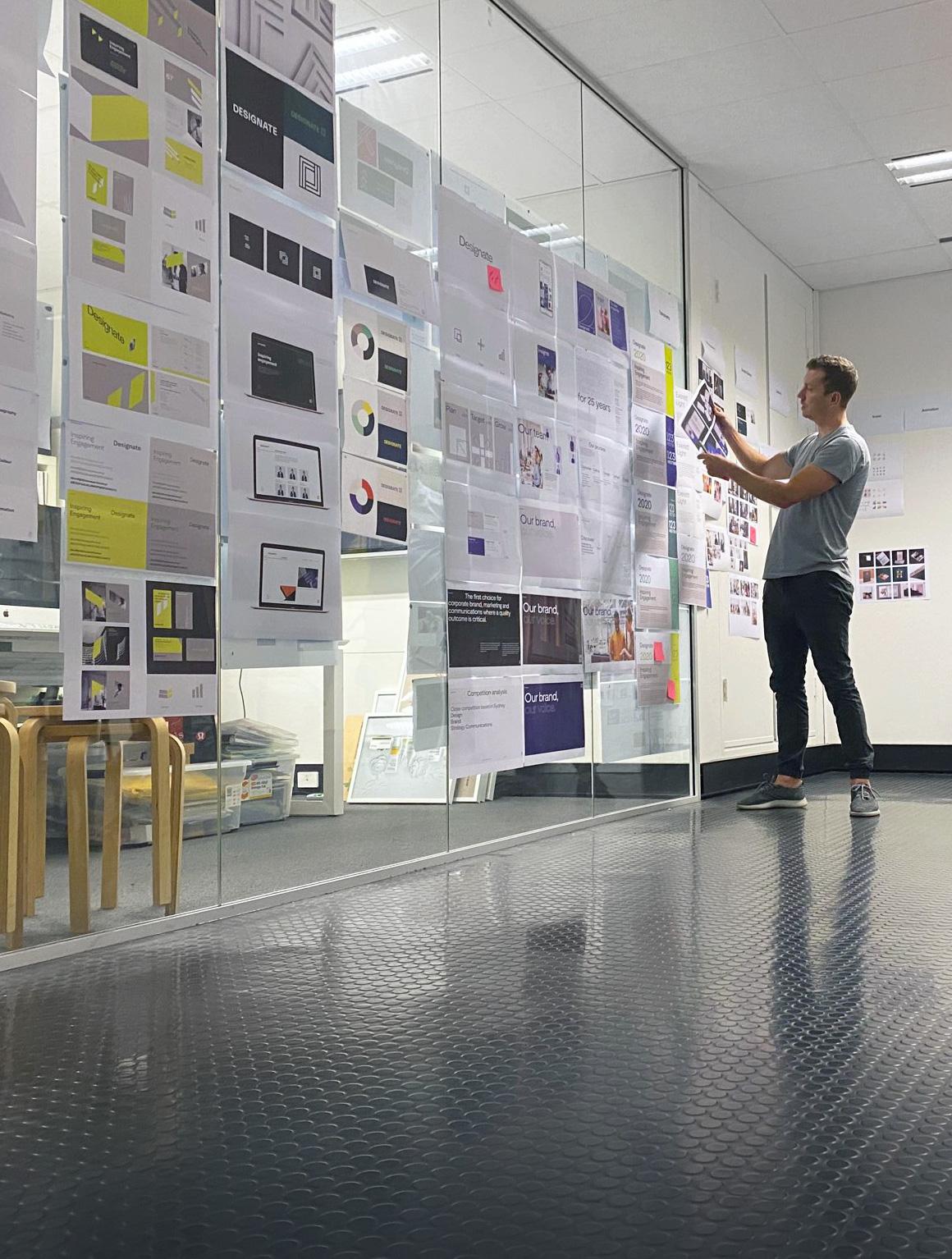 Designate Creative Director reviewing design work.