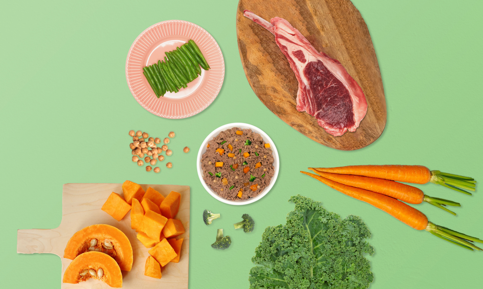 Food spread of raw beef, carrots, kale, chickpeas, green beans, broccoli and bowl of Kabo beef meal