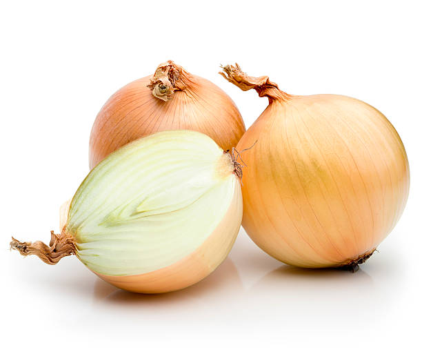 Onions Onions on a white background.  onion stock pictures, royalty-free photos & images