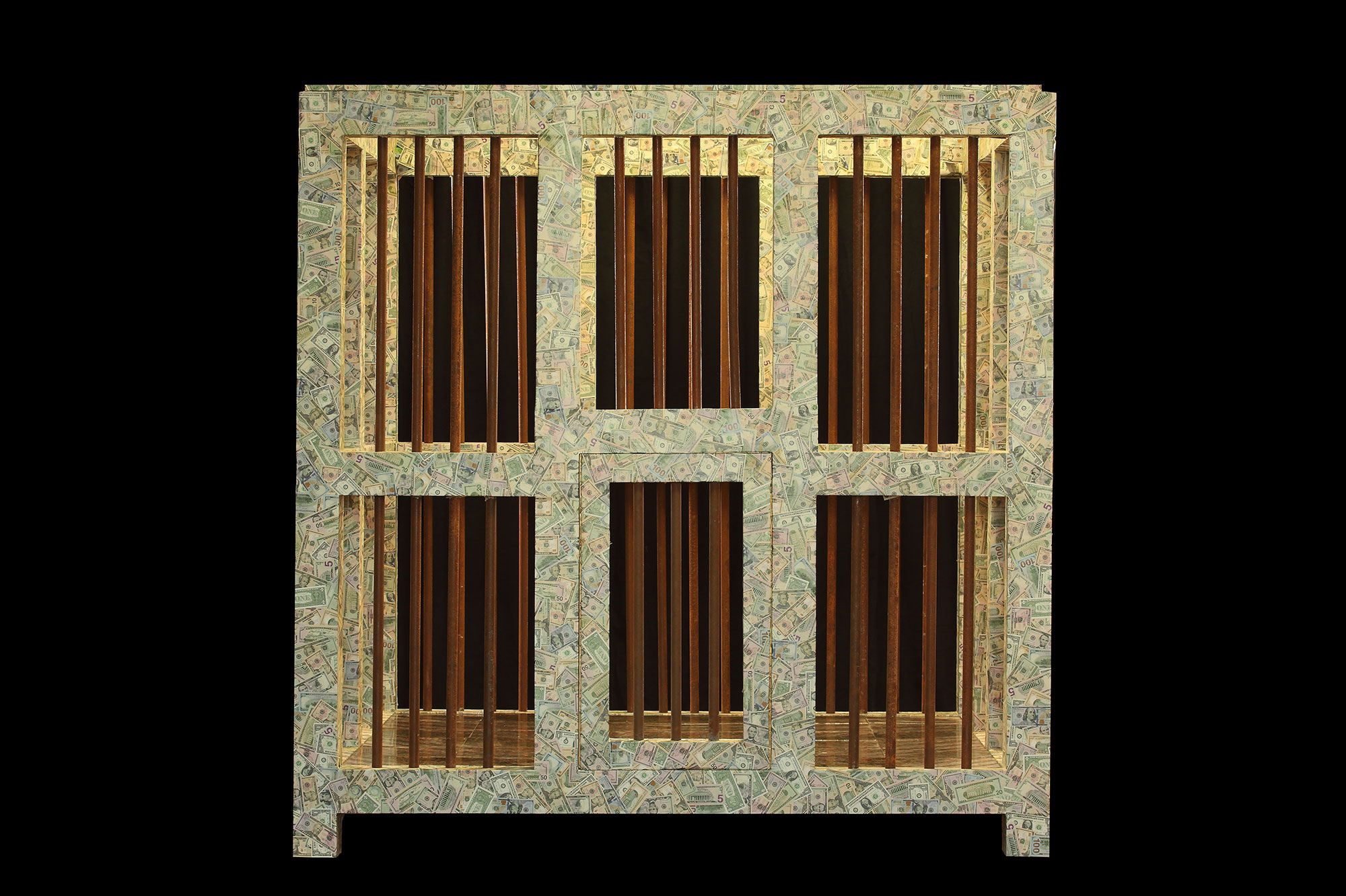 The Spell is a formidable 8-ft square wooden cage with old rusted bars. The cage is completely covered in paper money with a coin floor. The original display of this cage will feature a vibrant 4-ft stained glass earth, which is glowing from within and revolving.