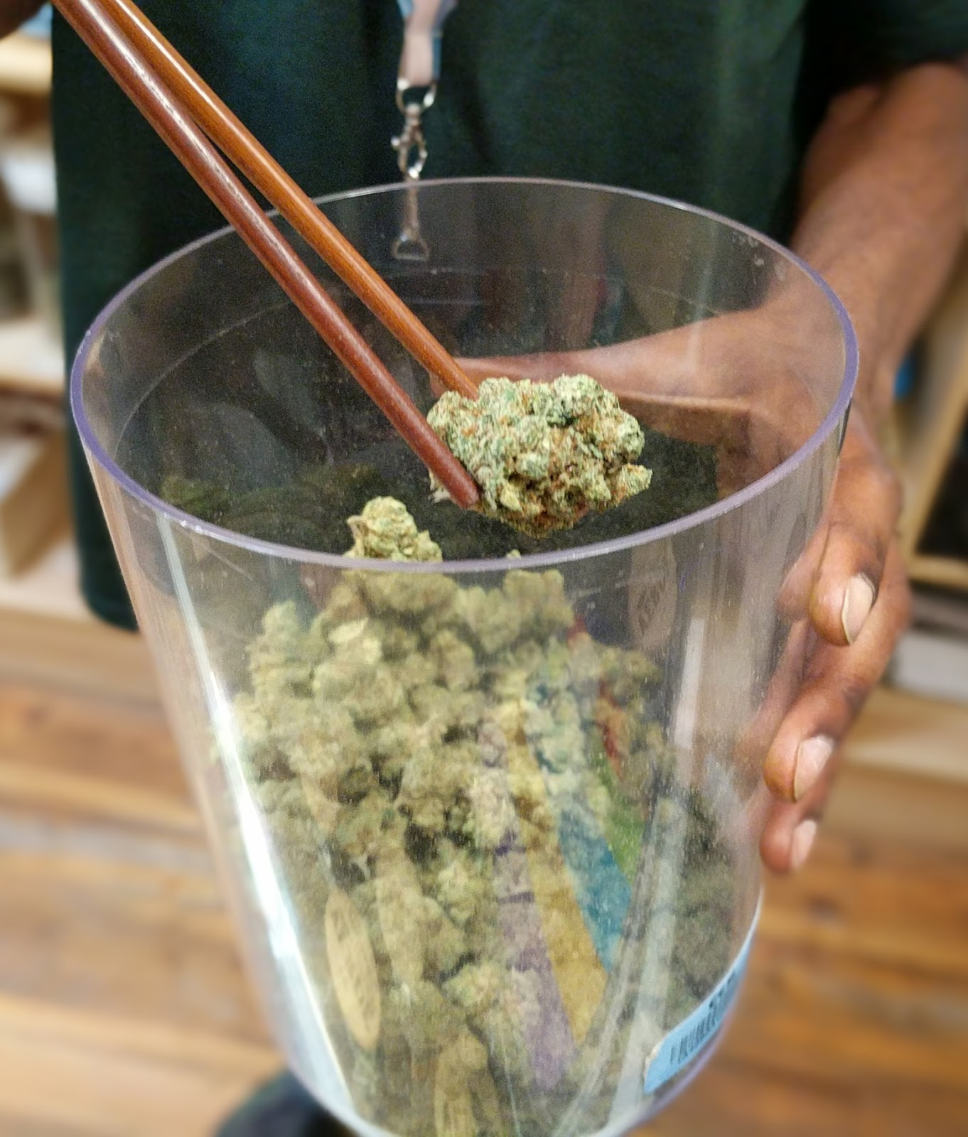 a bud at a dispensary being shown as you might see if you were to purchase legal cannabis to manage your anxiety.