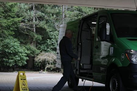 Employee entering work van