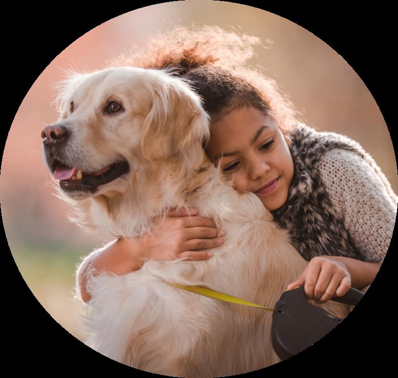 Girl and a dog hugging